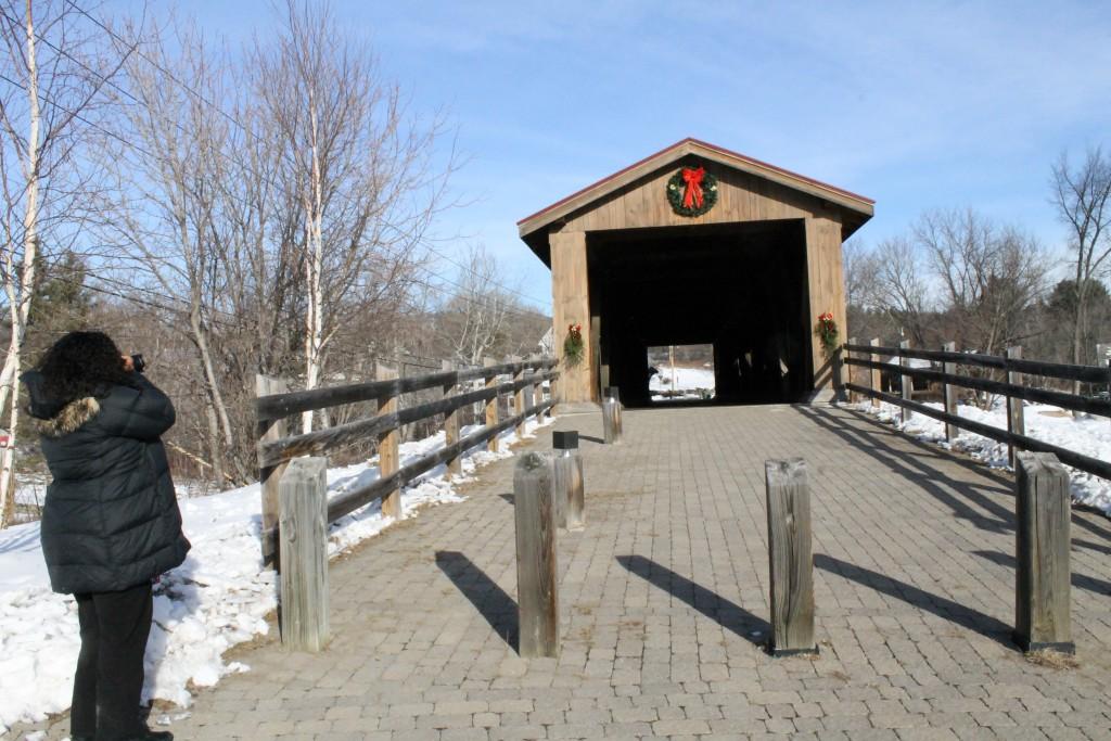 Carol Cain photographs the Jay Covered Bridge.