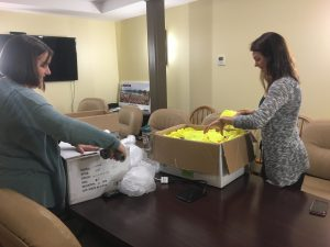 Kerry Shannon and Bethany Valenze pack up the boxes.