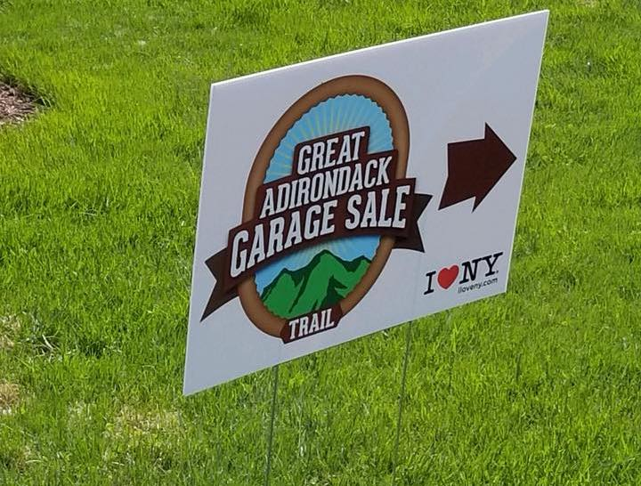 Yard sign with the Great Adirondack Garage Sale logo and arrow pointing right.