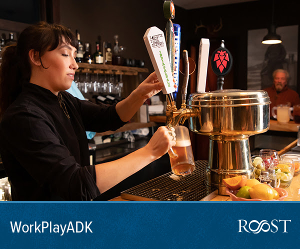 Bartender pours a glass of Adirondack IPA.