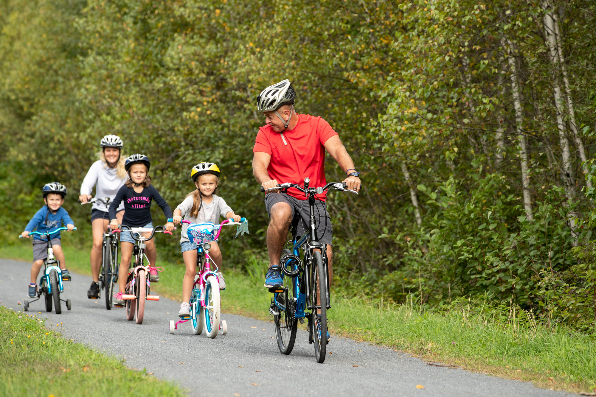 Family bikes the Junction Pass Trail in Tupper Lake
